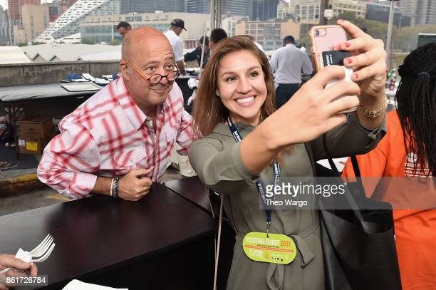 Andrew Zimmern poses with a fan at the Food Network Cooking Channel New York City Wine Food Festival Presented By CocaCola CocaCola Backyard BBQ...