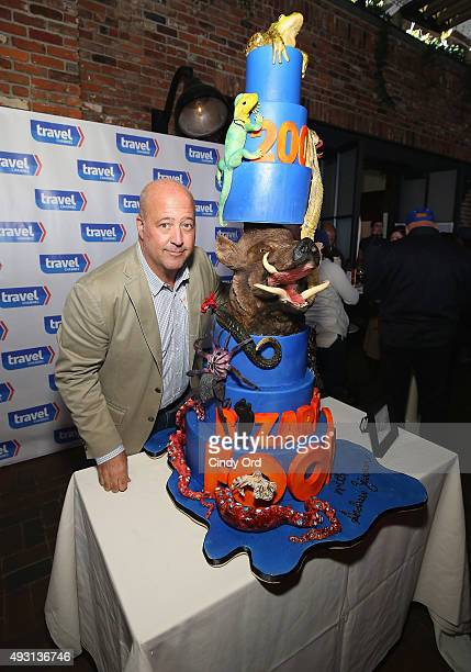 Andrew Zimmern poses with a special cake celebrating 200 episodes of Bizarre Foods at Top Dog A NY Hot Dog Competition Hosted By Andrew Zimmern part...