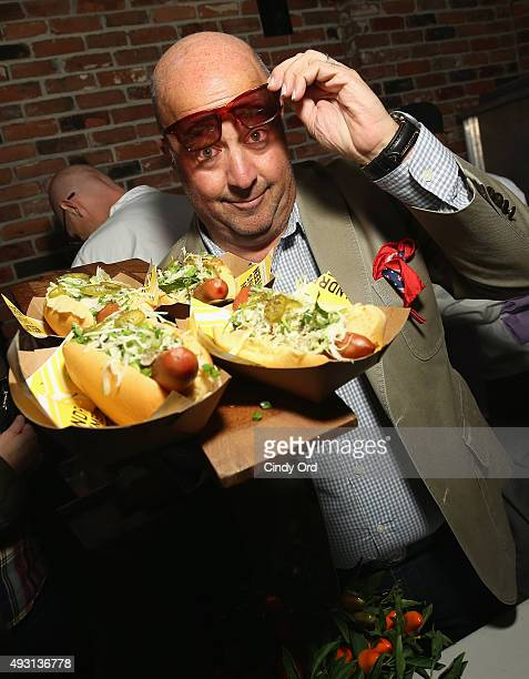 Andrew Zimmern poses with food at Top Dog A NY Hot Dog Competition Hosted By Andrew Zimmern part of LOCAL presented by Delta Air Lines during Food...