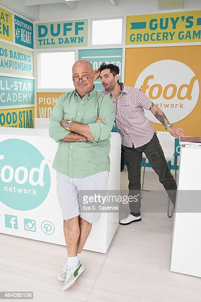 Andrew Zimmern poses with Gabriele Corcos at the KitchenAid Culinary Demonstrations during the 2015 Food Network Cooking Channel South Beach Wine...
