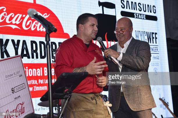 Andrew Zimmern presents Ed Randolph of Handsome Devil with the CocaCola Peoples Choice Award at the Food Network Cooking Channel New York City Wine...