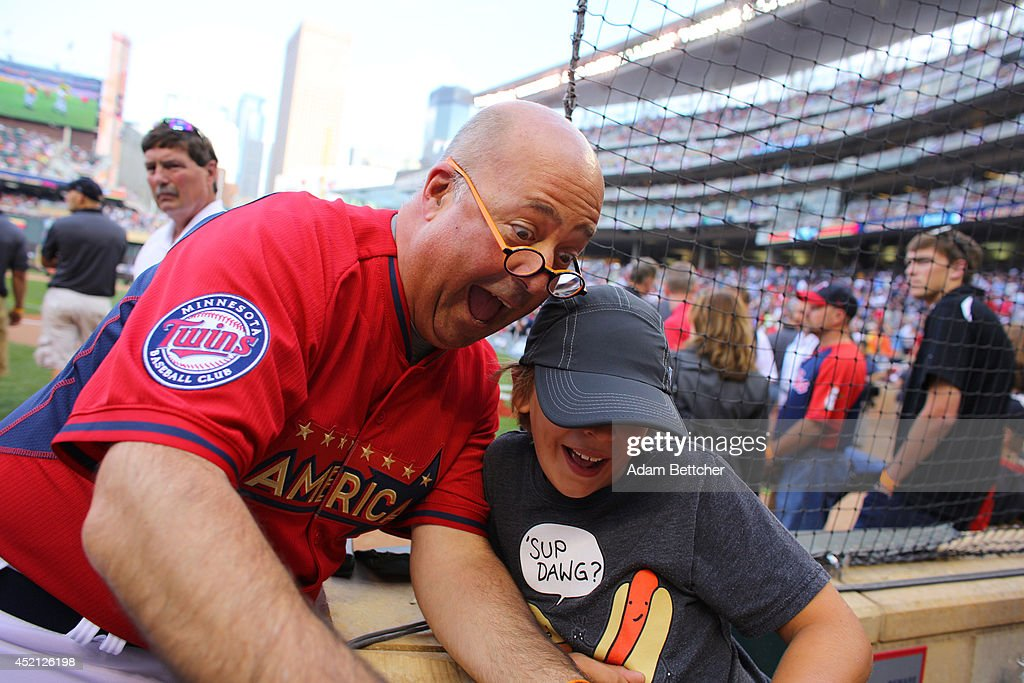<a gi-track='captionPersonalityLinkClicked' href=/galleries/search?phrase=Andrew+Zimmern&family=editorial&specificpeople=4525179 ng-click='$event.stopPropagation()'>Andrew Zimmern</a> takes a selfie with a fan before the 2014 MLB All-Star legends and celebrity softball game on July 13, 2014 at the Target Field in Minneapolis, Minnesota.