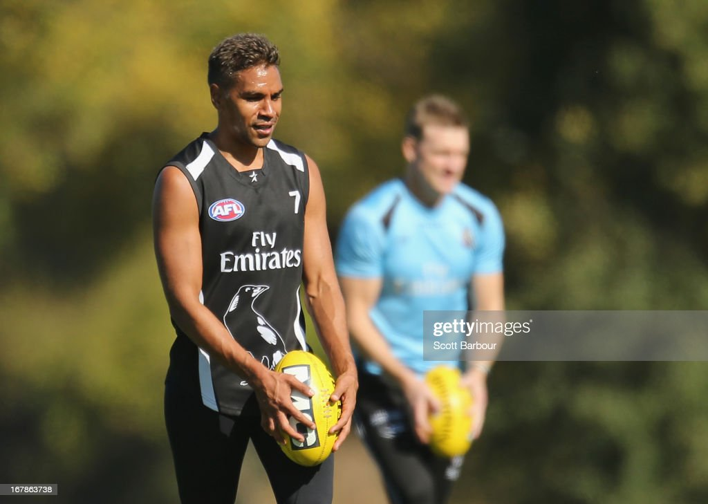 AndrewKrakouer and Magpies coach <a gi-track='captionPersonalityLinkClicked' href=/galleries/search?phrase=Nathan+Buckley&family=editorial&specificpeople=176545 ng-click='$event.stopPropagation()'>Nathan Buckley</a> prepare to kick the ball during a Collingwood Magpies AFL training session at Olympic Park on May 2, 2013 in Melbourne, Australia.