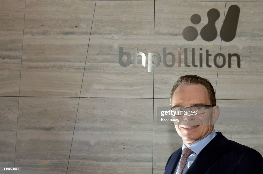 AndrewMackenzie, chief executive officer of BHP Billiton Ltd., poses for a photograph at the company's headquarters in Melbourne, Australia, on Tuesday, Aug. 22, 2017. BHPflagged plans to divest its U.S shale unit --acquired by the world's biggest miner in a $20 billiondeals spreein 2011 -- after a campaign by activist investors, includingElliott Management Corp, to exit the business. Photographer: Carla Gottgens/Bloomberg via Getty Images