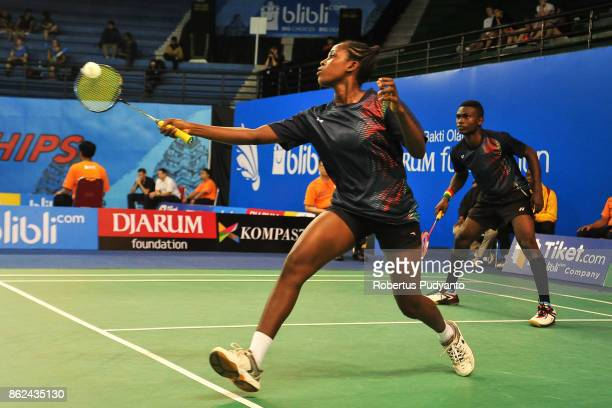 Andrews Ebenezer and Eyram Yaa Migbodzi of Ghana compete against Harry Huang and Pamela Reyes of England during Mixed Double qualification round of...