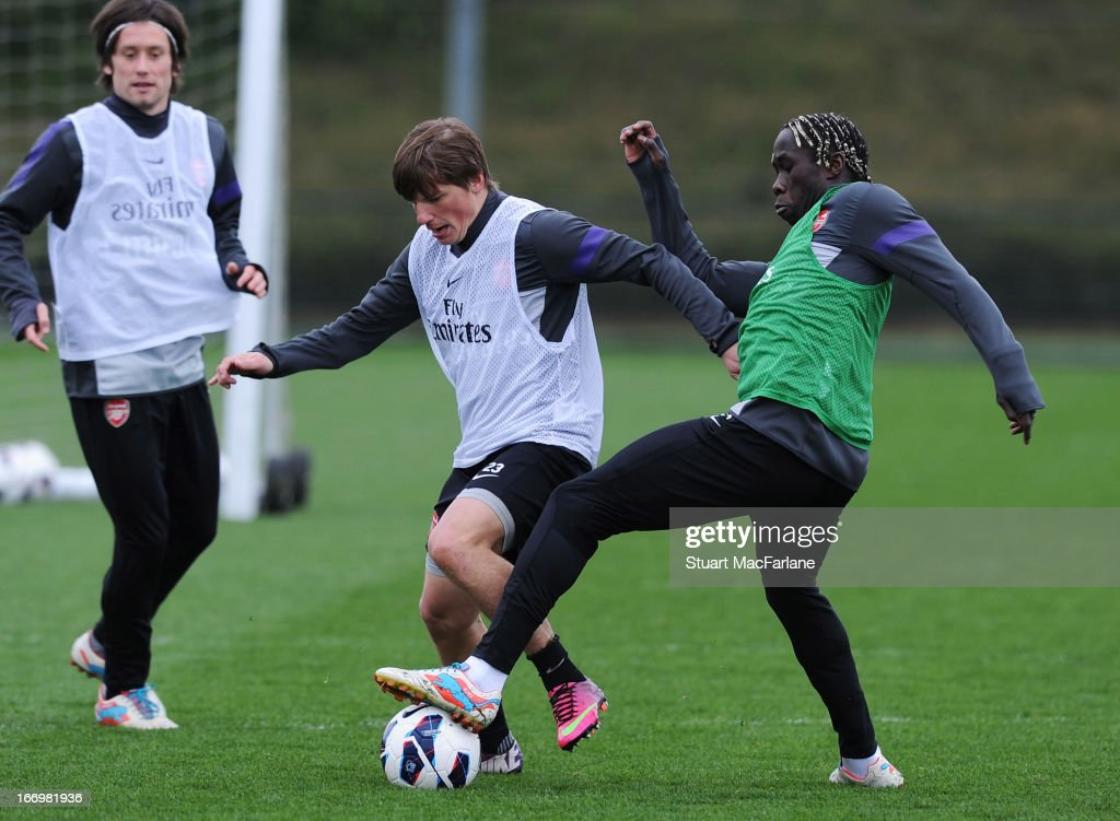 Andrey Arsahvin and Bacary Sagna of Arsenal during a training session at London Colney on April 19, 2013 in St Albans, England.
