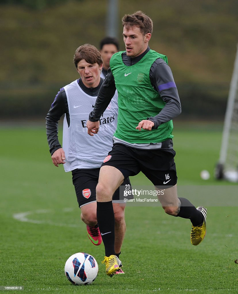 Andrey Arshavin and Aaron Rasmey of Arsenal during a training session at London Colney on April 19, 2013 in St Albans, England.