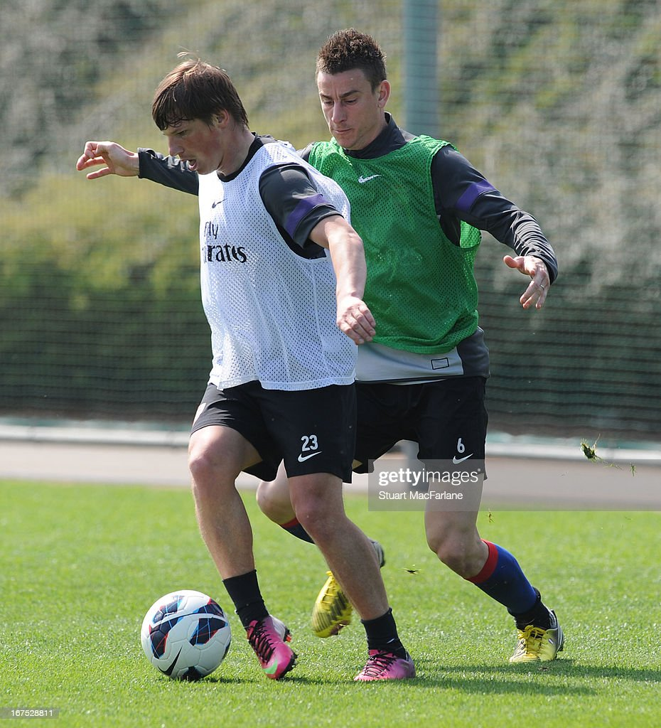 Andrey Arshavin and Laurent Koscielny of Arsenal during a training session at London Colney on April 26, 2013 in St Albans, England.