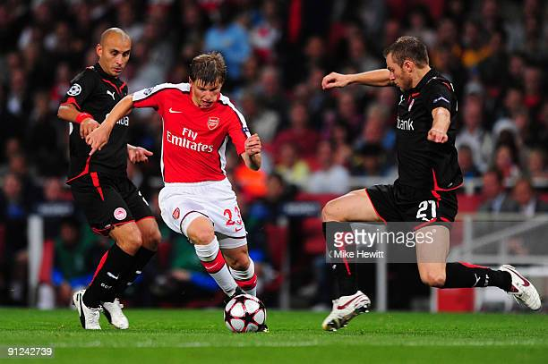Andrey Arshavin of Arsenal battles for the ball with Avraam Papadopoulo of Olympiakos during the UEFA Champions League Group H match between Arsenal...