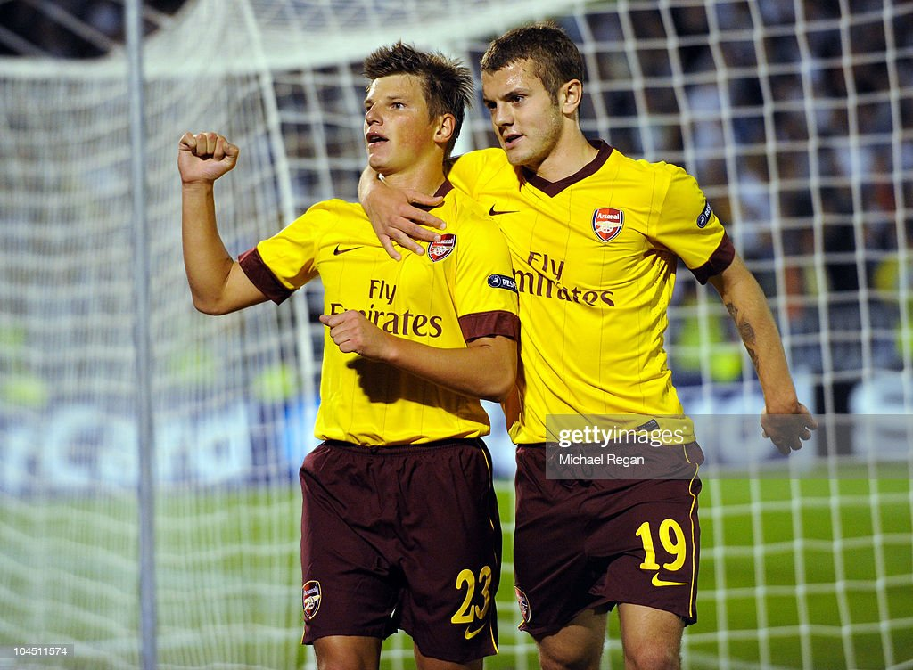 Andrey Arshavin of Arsenal (L) celebrates scoring his team's first goal with <a gi-track='captionPersonalityLinkClicked' href=/galleries/search?phrase=Jack+Wilshere&family=editorial&specificpeople=5446655 ng-click='$event.stopPropagation()'>Jack Wilshere</a> during the UEFA Champions League Group H match between FK Partizan and Arsenal at the Partizan Stadium on September 28, 2010 in Belgrade, Serbia.