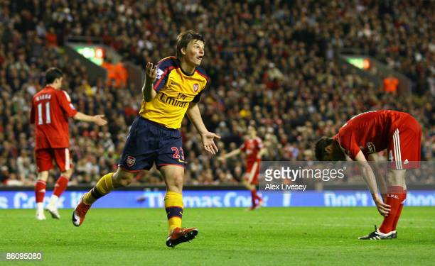Andrey Arshavin of Arsenal celebrates scoring his team's third goal and his hat trick during the Barclays Premier League match between Liverpool and...