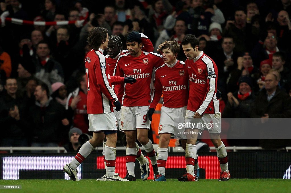 Andrey Arshavin of Arsenal is congratulated after scoring his teams fourth goal during the Barclays Premier League match between Arsenal and Bolton Wanderers at The Emirates Stadium on January 20, 2010 in London, England.