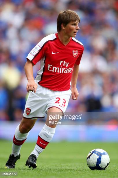Andrey Arshavin of Arsenal runs with the ball during the Emirates Cup match between Arsenal and Glasgow Rangers at the Emirates Stadium on August 2...