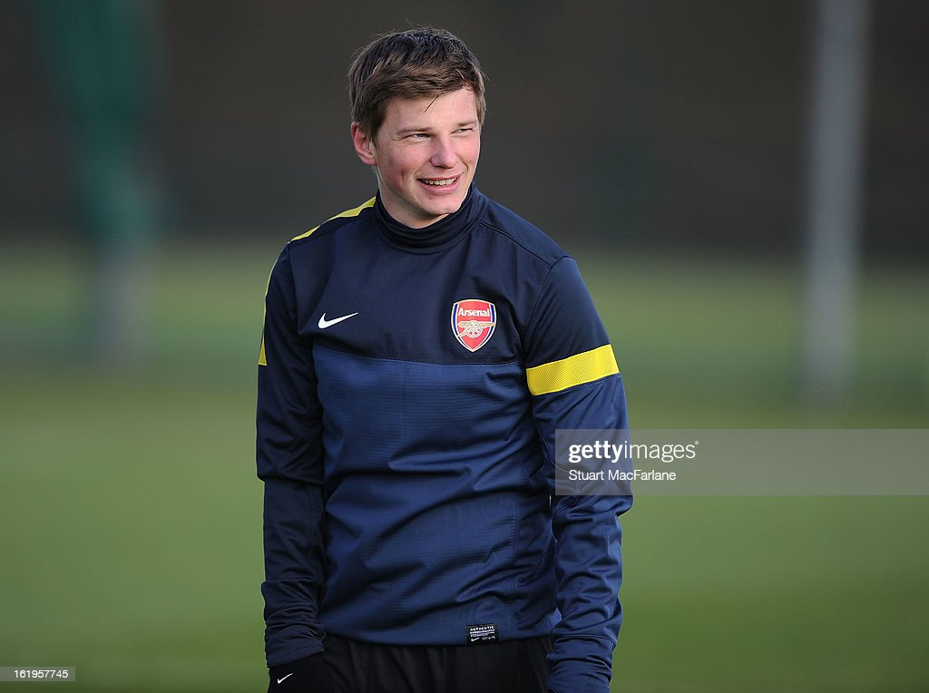 Andrey Arshavin of Arsenal smiles a training session ahead of their UEFA Champions League match against FC Bayern Muenchen at London Colney on February 18, 2013 in St Albans, England.