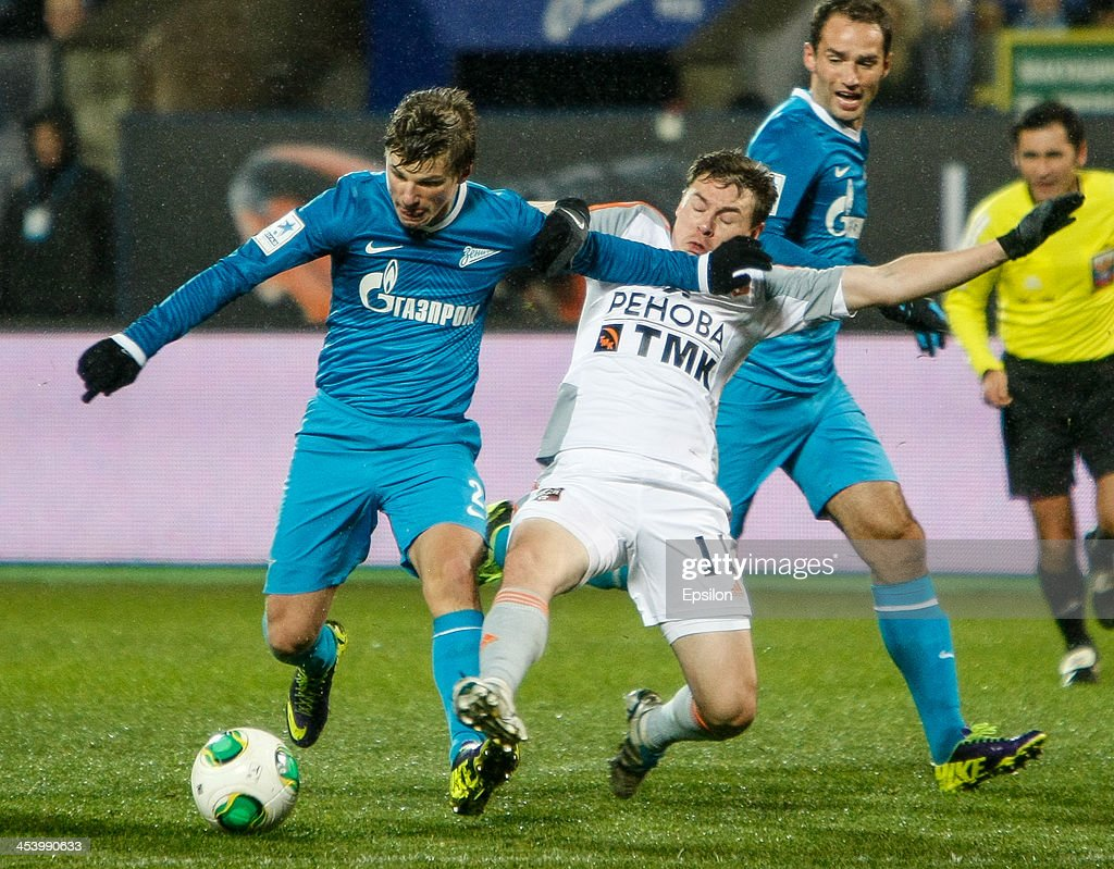 Andrey Arshavin of FC Zenit St. Petersburg (L) vies for the ball with Aleksandr Shchanitsyn of FC Ural Sverdlovsk Oblast during the Russian Football League Championship match between FC Zenit St. Petersburg and FC Ural Sverdlovsk Oblast at the Petrovsky stadium on December 6, 2013 in St. Petersburg, Russia.