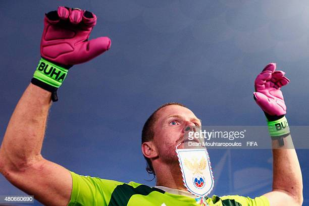 Andrey Bukhlitskiy of Russia holds a russia pennant in his mouth in the players tunnel prior to the Group D FIFA Beach Soccer World Cup match between...