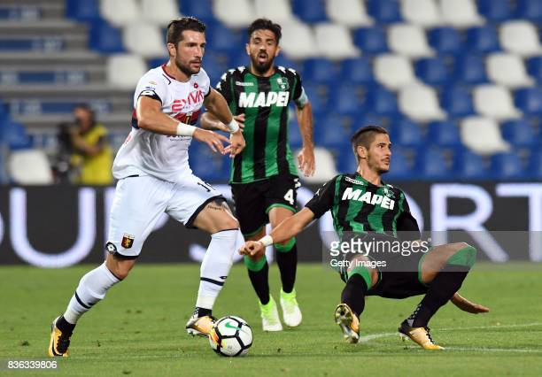 Andrey Galabinov of Genoa CFC competes for the ball whit'n Diego Falcinelli of US Sassuolo during the Serie A match between US Sassuolo and Genoa CFC...