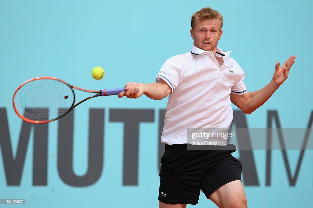 <a gi-track='captionPersonalityLinkClicked' href=/galleries/search?phrase=Andrey+Golubev&family=editorial&specificpeople=5369471 ng-click='$event.stopPropagation()'>Andrey Golubev</a> of Kazakhstan plays a forehand against Nicolas Almagro of Spain during day four of the Mutua Madrid Open tennis tournament at the Caja Magica on May 6, 2014 in Madrid, Spain.