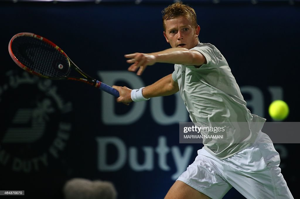 <a gi-track='captionPersonalityLinkClicked' href=/galleries/search?phrase=Andrey+Golubev&family=editorial&specificpeople=5369471 ng-click='$event.stopPropagation()'>Andrey Golubev</a> of Kazakhstan returns the ball to world number one tennis player Novak Djokovic of Serbia during their match on the third day of the ATP Dubai Duty Free Tennis Championships February 25, 2015 in Dubai.