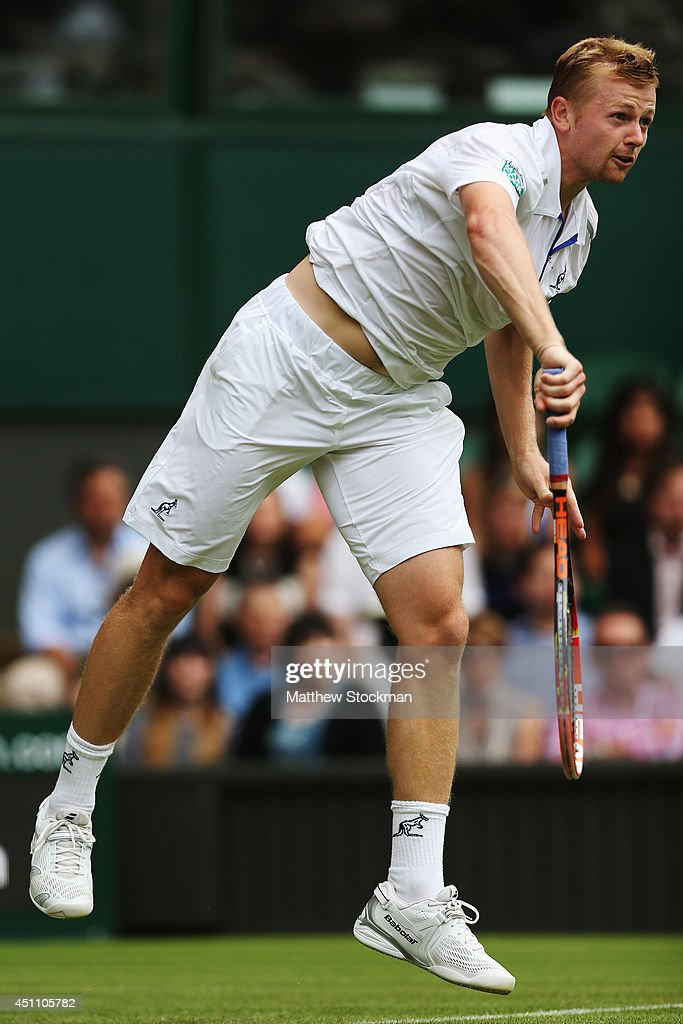 <a gi-track='captionPersonalityLinkClicked' href=/galleries/search?phrase=Andrey+Golubev&family=editorial&specificpeople=5369471 ng-click='$event.stopPropagation()'>Andrey Golubev</a> of Kazakhstan serves to Novak Djokovic of Serbia during their Gentlemen's Singles first round match on day one of the Wimbledon Lawn Tennis Championships at the All England Lawn Tennis and Croquet Club at Wimbledon on June 23, 2014 in London, England.
