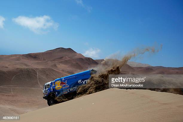 Andrey Karginov Andrey Mokeev and Igor Devyatkin of Russia for Kamaz Master compete in stage 9 during Day 10 of the 2014 Dakar Rally on January 14...