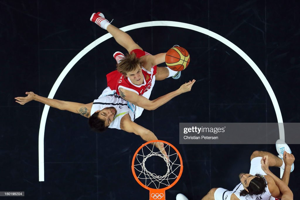 Andrey Kirilenko #15 of Russia puts up a shot during the Men's Basketball bronze medal game between Russia and Argentina on Day 16 of the London 2012 Olympics Games at North Greenwich Arena on August 12, 2012 in London, England.
