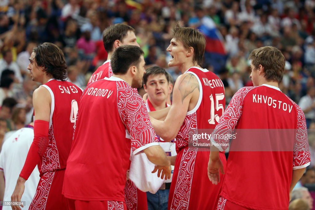 Andrey Kirilenko #15 of Russia reacts with teammates <a gi-track='captionPersonalityLinkClicked' href=/galleries/search?phrase=Timofey+Mozgov&family=editorial&specificpeople=3949705 ng-click='$event.stopPropagation()'>Timofey Mozgov</a> #5 and <a gi-track='captionPersonalityLinkClicked' href=/galleries/search?phrase=Evgeny+Voronov&family=editorial&specificpeople=7162259 ng-click='$event.stopPropagation()'>Evgeny Voronov</a> #18 while taking on Spain during the Men's Basketball semifinal match on Day 14 of the London 2012 Olympic Games at the North Greenwich Arena on August 10, 2012 in London, England.