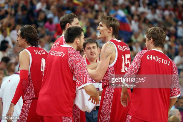 Andrey Kirilenko of Russia reacts with teammates Timofey Mozgov and Evgeny Voronov while taking on Spain during the Men's Basketball semifinal match...