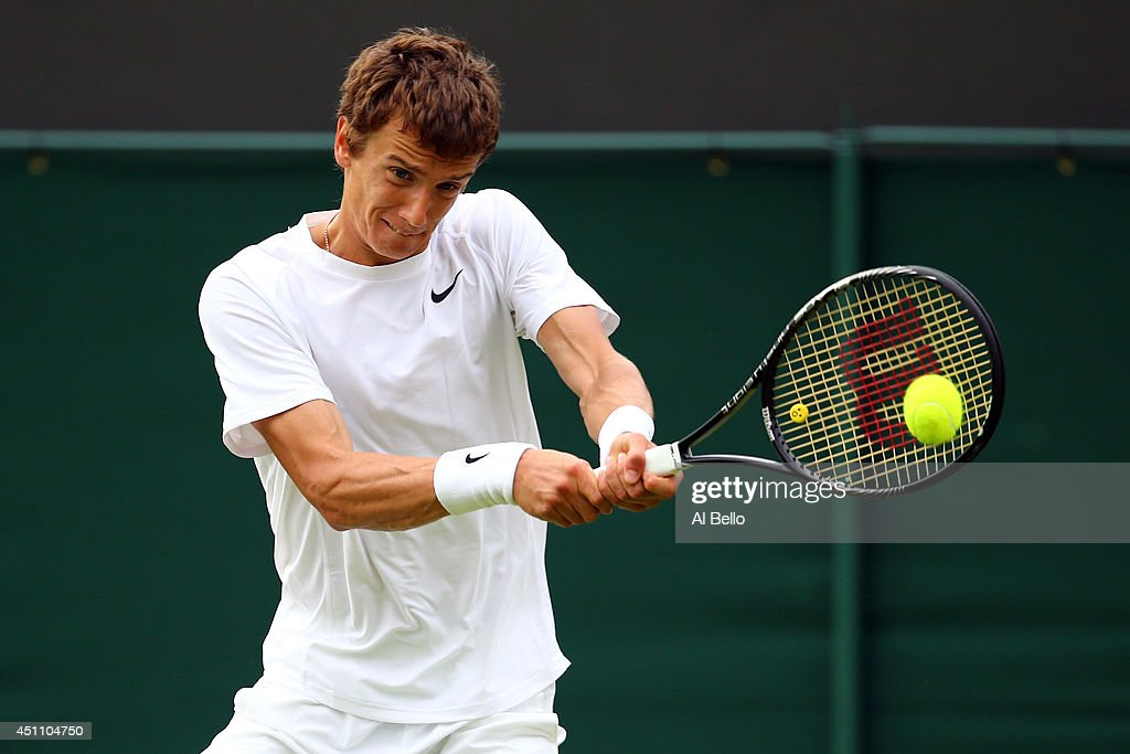 <a gi-track='captionPersonalityLinkClicked' href=/galleries/search?phrase=Andrey+Kuznetsov+-+Tennis+Player&family=editorial&specificpeople=5892238 ng-click='$event.stopPropagation()'>Andrey Kuznetsov</a> of Russia in action during his Gentlemen's Singles first round match against Daniel Evans of Great Britain on day one of the Wimbledon Lawn Tennis Championships at the All England Lawn Tennis and Croquet Club at Wimbledon on June 23, 2014 in London, England.