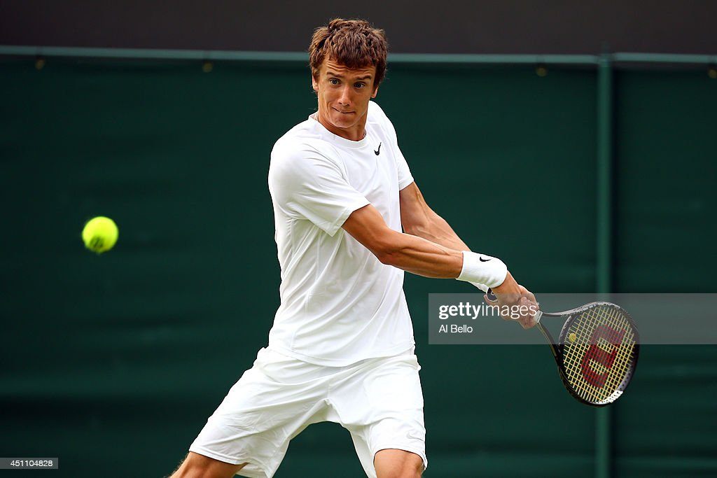 Andrey Kuznetsov of Russia in action during his Gentlemen's Singles first round match against Daniel Evans of Great Britain on day one of the Wimbledon Lawn Tennis Championships at the All England Lawn Tennis and Croquet Club at Wimbledon on June 23, 2014 in London, England.