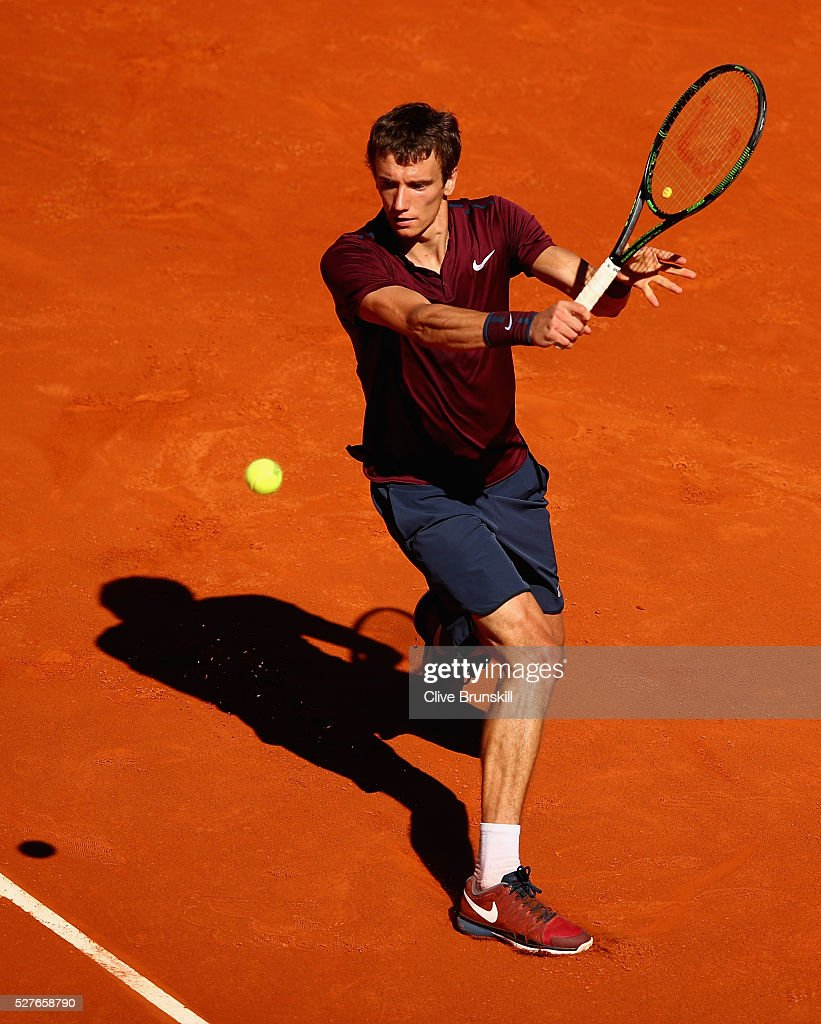 Andrey Kuznetsov of Russia plays a backhand against Rafael Nadal of Spain in their second round match during day four of the Mutua Madrid Open tennis tournament at the Caja Magica on May 03, 2016 in Madrid,Spain.