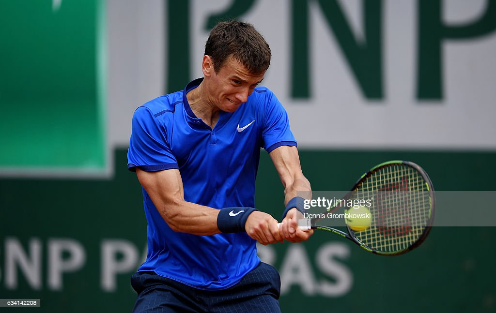 Andrey Kuznetsov of Russia plays a backhand during the Men's Singles second round match against Kei Nishikori of Japan at Roland Garros on May 25, 2016 in Paris, France.