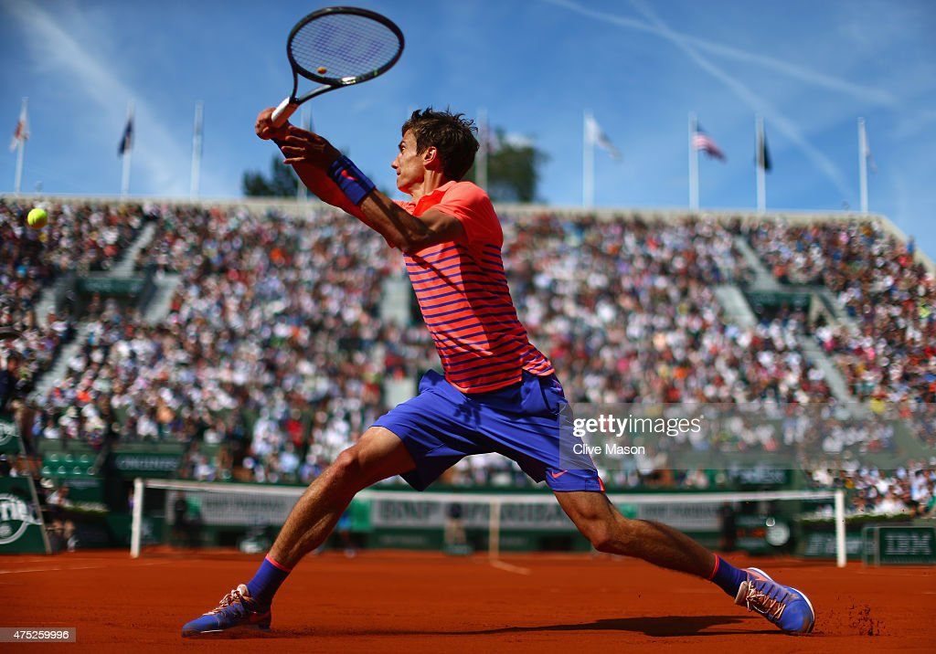 Andrey Kuznetsov of Russia plays a backhand in his Men's Singles match against Rafael Nadal of Spain on day seven of the 2015 French Open at Roland Garros on May 30, 2015 in Paris, France.