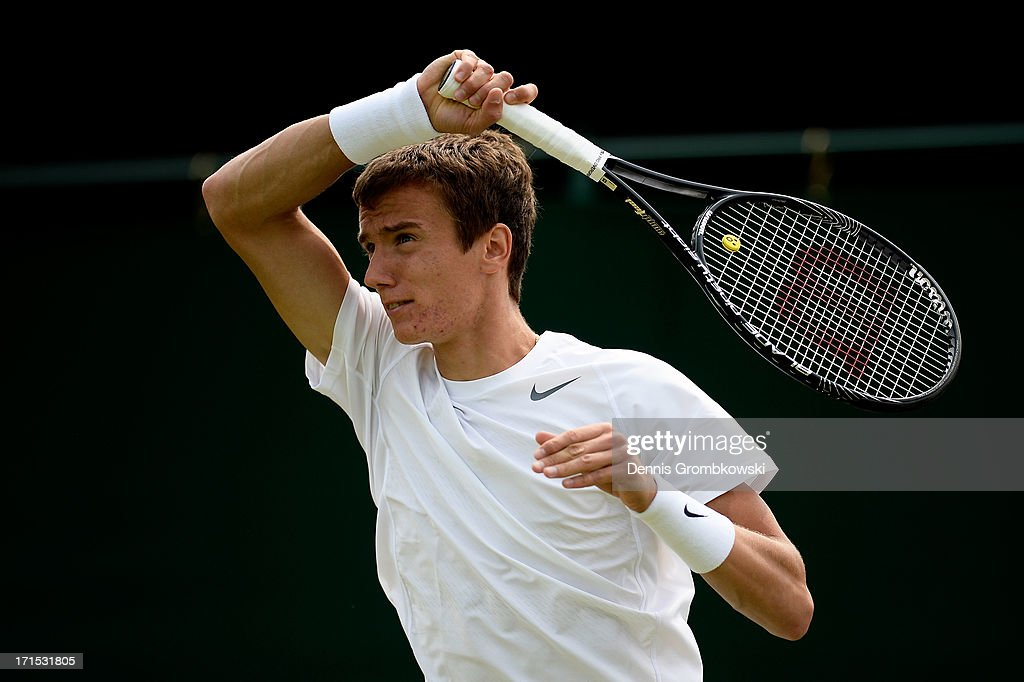 Andrey Kuznetsov of Russia plays a forehand during his Gentlemen's Singles second round match against Viktor Troicki of Serbia on day three of the Wimbledon Lawn Tennis Championships at the All England Lawn Tennis and Croquet Club on June 26, 2013 in London, England.