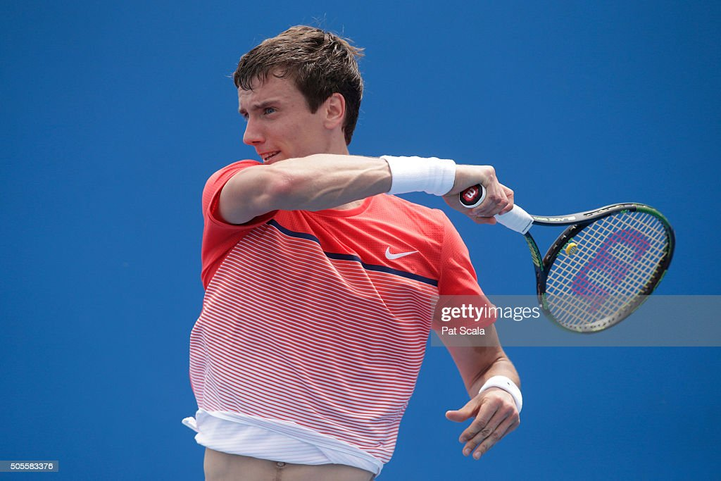 Andrey Kuznetsov of Russia plays a forehand in his first round match against Ryan Harrison of the United States during day two of the 2016 Australian Open at Melbourne Park on January 19, 2016 in Melbourne, Australia.