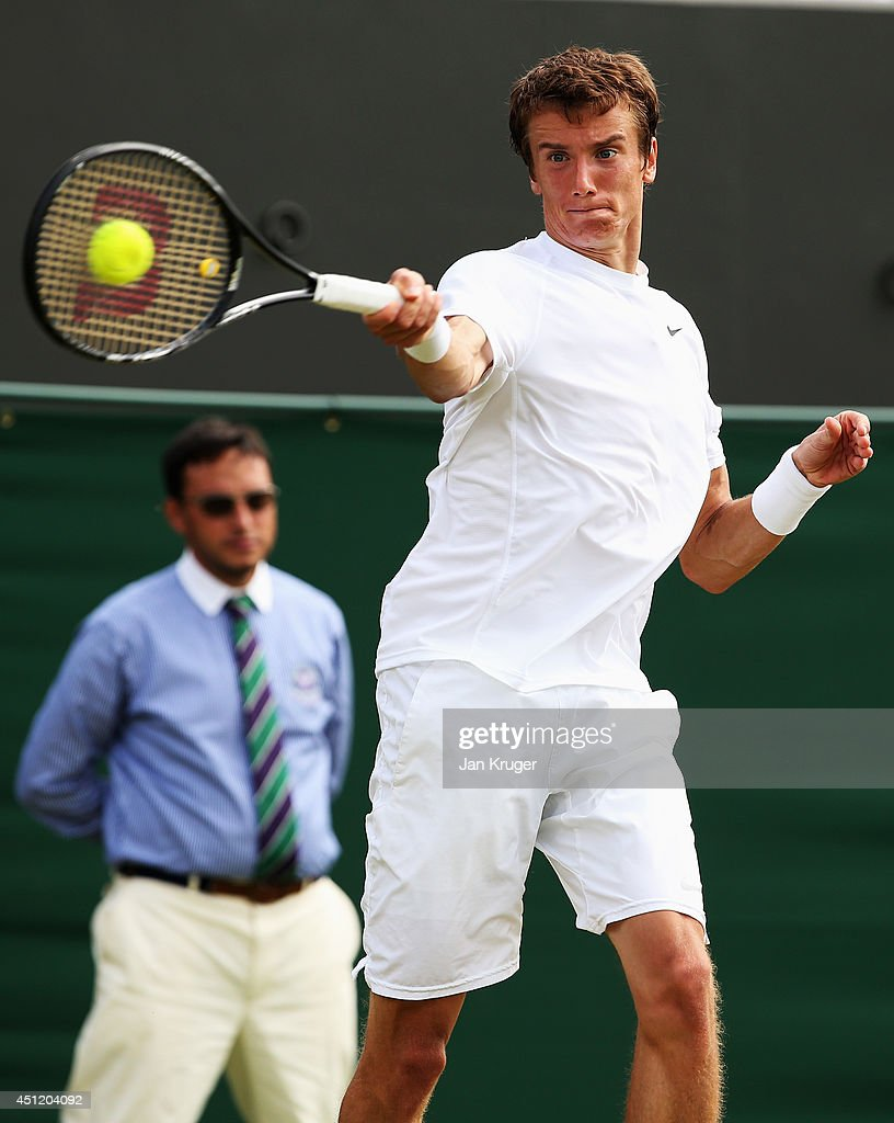 <a gi-track='captionPersonalityLinkClicked' href=/galleries/search?phrase=Andrey+Kuznetsov+-+Tennis+Player&family=editorial&specificpeople=5892238 ng-click='$event.stopPropagation()'>Andrey Kuznetsov</a> of Russia plays a forehand shot during his Gentlemen's Singles second round match against David Ferrer of Spain on day three of the Wimbledon Lawn Tennis Championships at the All England Lawn Tennis and Croquet Club at Wimbledon on June 25, 2014 in London, England.
