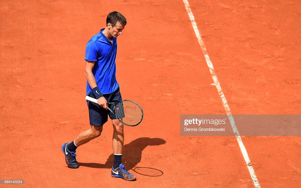 Andrey Kuznetsov of Russia reacts during the Men's Singles second round match against Kei Nishikori of Japan at Roland Garros on May 25, 2016 in Paris, France.