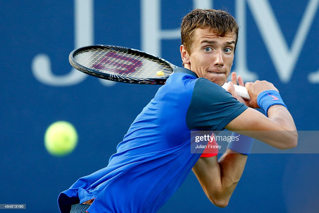 Andrey Kuznetsov of Russia returns a shot against Fernando Verdasco of Spain on Day Four of the 2014 US Open at the USTA Billie Jean King National Tennis Center on August 28, 2014 in the Flushing neighborhood of the Queens borough of New York City.