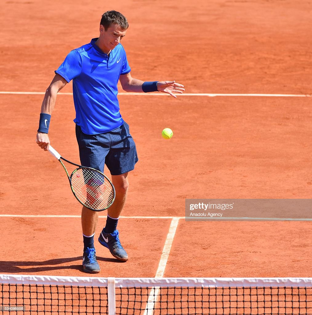 Andrey Kuznetsov of Russia returns the ball to Kei Nishikori (not seen) of during their men's single 2nd round match at the French Open tennis tournament at Roland Garros in Paris, France on May 25, 2016.