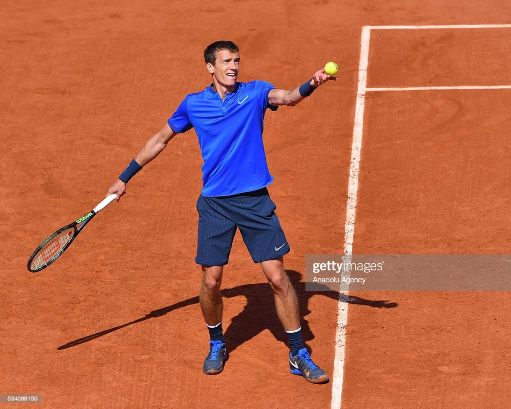 Andrey Kuznetsov of Russia serves to Kei Nishikori (not seen) of during their men's single 2nd round match at the French Open tennis tournament at Roland Garros in Paris, France on May 25, 2016.