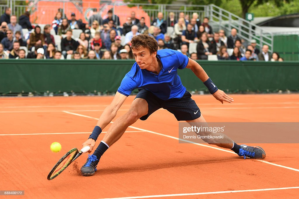 <a gi-track='captionPersonalityLinkClicked' href=/galleries/search?phrase=Andrey+Kuznetsov+-+Tennis+Player&family=editorial&specificpeople=5892238 ng-click='$event.stopPropagation()'>Andrey Kuznetsov</a> of Russia volleys during the Men's Singles first round match against Benjamin Becker of Germany on day one of the 2016 French Open at Roland Garros on May 22, 2016 in Paris, France.