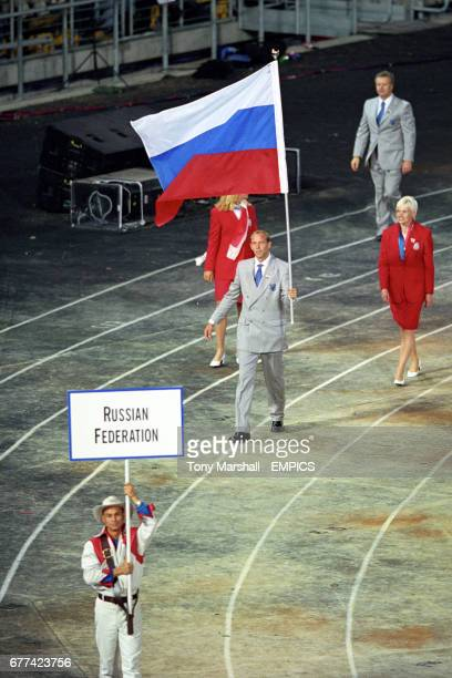 Andrey Lavrov carries the Russian flag during the Opening Ceremony