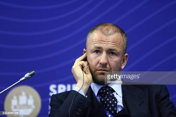 Andrey Melnichenko billionaire and chairman of EuroChem AG listens through an earpiece during a panel session on day two of the St Petersburg...