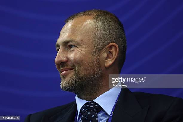 Andrey Melnichenko billionaire and chairman of EuroChem AG reacts during a panel session on day two of the St Petersburg International Economic Forum...
