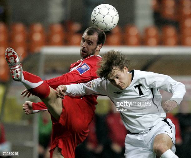Andrey Perov of Torpedo Moscow goes for a header against Fernando Cavenaghi of Spartak Moscow during the Russian League football championship match...