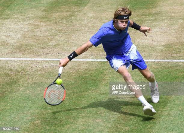Andrey Rublev from Russia returns the ball to Karen Khachanov from Russia during the ATP tournament tennis match in Halle western Germany on June 23...