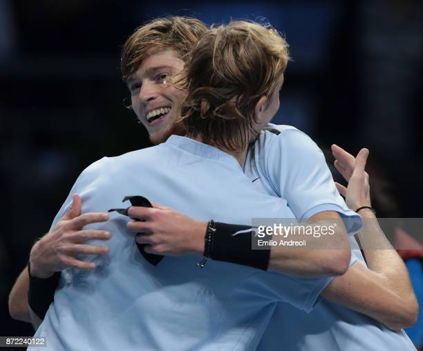 Andrey Rublev of Russia embraces Denis Shapovalov of Canada at the end of the match during Day 3 of the Next Gen ATP Finals on November 9 2017 in...