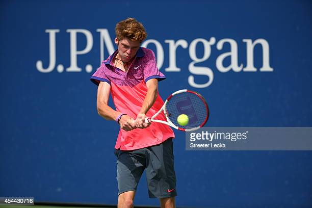 Andrey Rublev of Russia in action against Dennis Uspensky of the United States during their junior boys' singles first round match on Day Seven of...