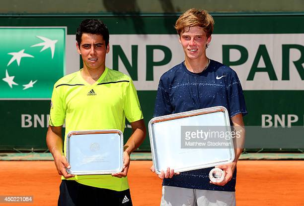 Andrey Rublev of Russia poses next to Jaume Antoni Munar Clar of Spain with their trophies after his victory in their boys' singles final match on...
