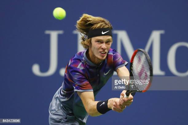 Andrey Rublev of Russia returns a shot against Rafael Nadal of Spain during their Men's Singles Quarterfinal match on Day Ten of the 2017 US Open at...